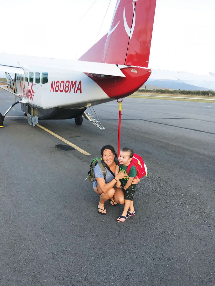 mom and son in front of plane molokai hawaii