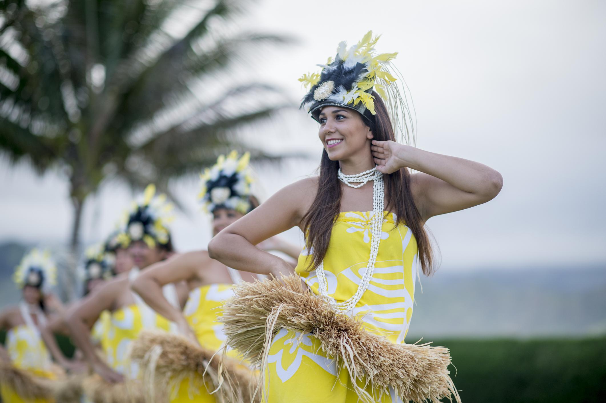 Woman Leading The Luau Performance