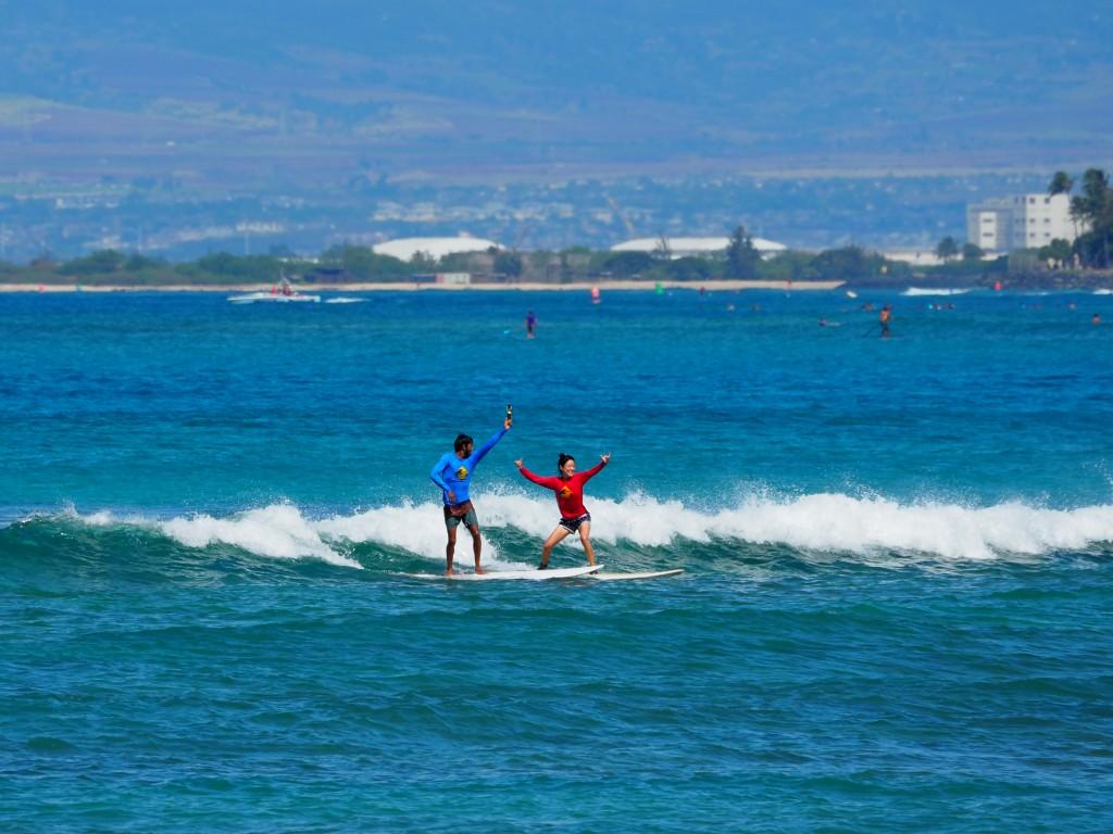 Girl Having Fun Practicing On Surfboard