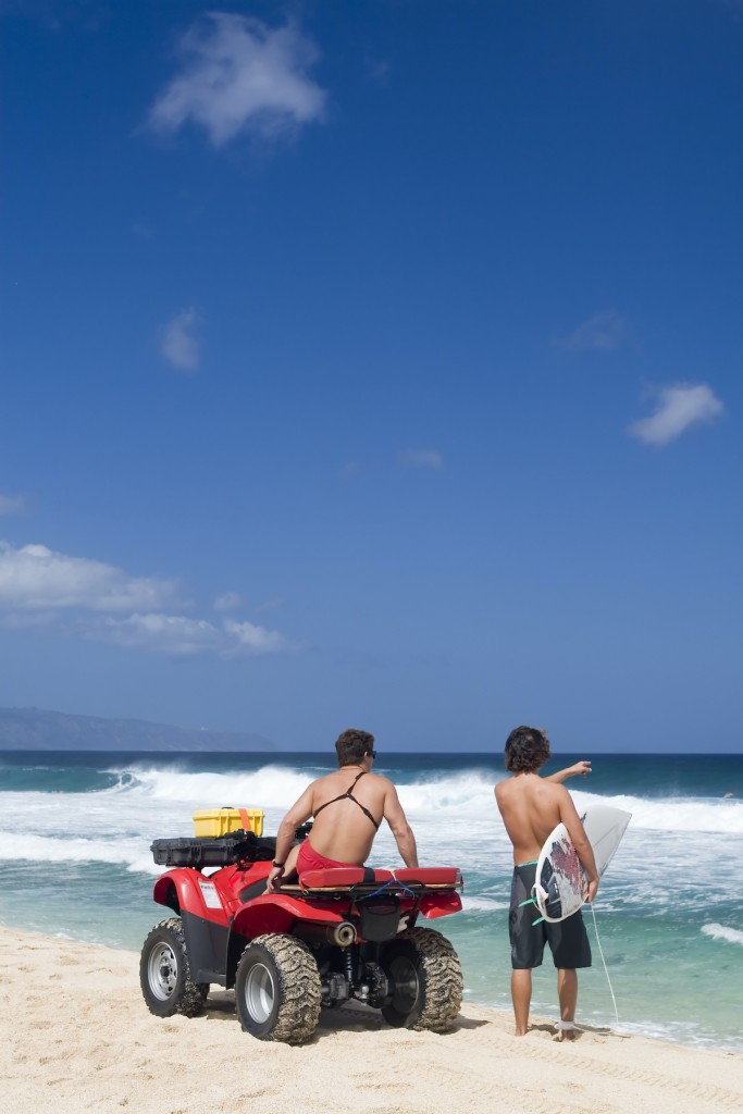 Lifeguard And Surfer On Beach