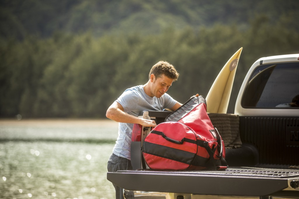 Young Man On Surfing Road Trip In Hawaii.
