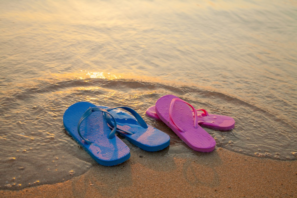Female And Male Flip Flpp Sandals On The Beach